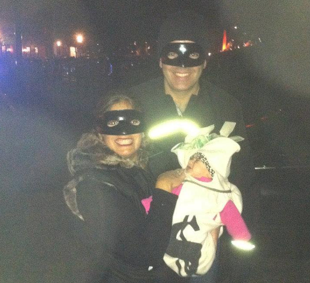 Mom and Dad and baby as cat burglar and money bag on Halloween